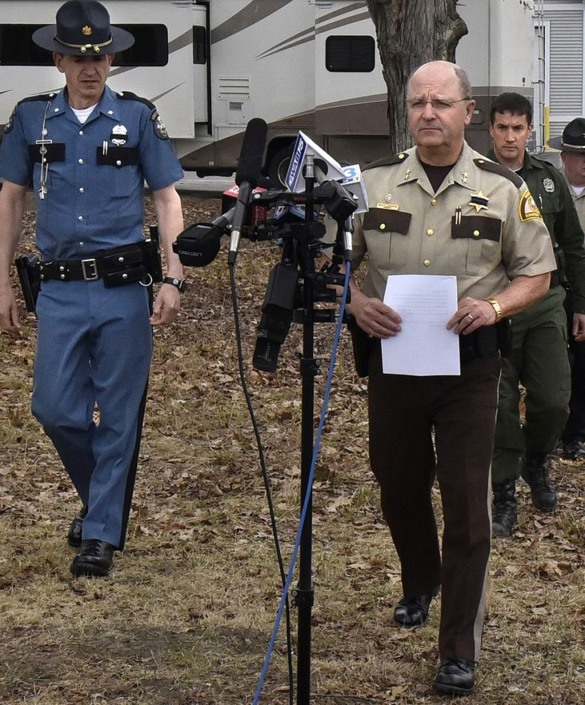 Somerset Sheriff Dale Lancaster, right, and Lt. Col. John Cote, left, of the Maine State Police spoke during a press conference on Saturday regarding search for murder suspect John Williams. Game warden Lt. Daniel Scott is at right.