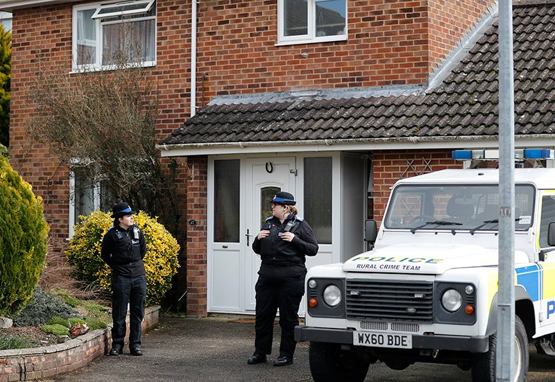 Police officers stand outside the house of former Russian double agent Sergei Skripal in Salisbury in Marcxh. British police say they believe a Russian ex-spy and his daughter first came into contact with a military-grade nerve agent at their front door.