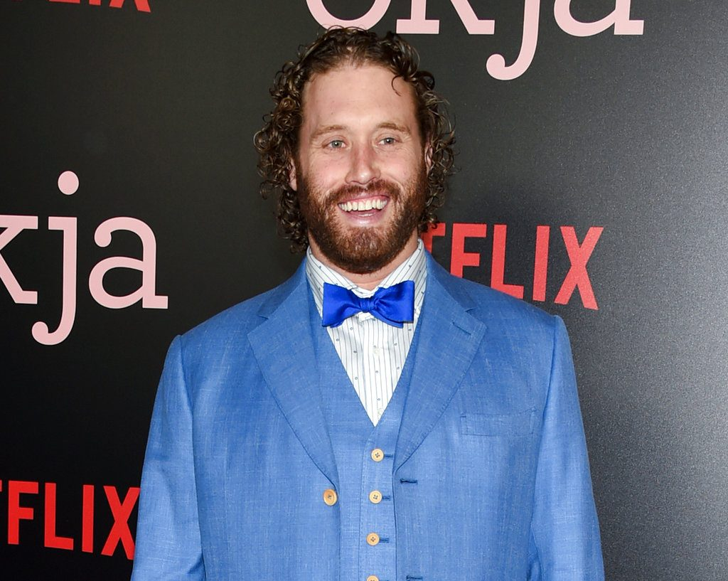 "T.J. Miller attends the premiere of Netflix's ""Okja"" in New York in 2017. Authorities searched a  train he was on after he allegedly called 911 and reported a false bomb threat."