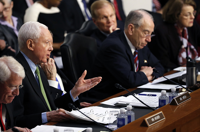 Sen. Orrin Hatch R-Utah second from left questions Facebook CEO Mark Zuckerberg during a joint hearing of the Commerce and Judiciary Committees