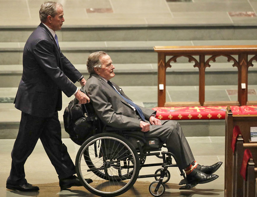 Former Presidents George W. Bush, left, and George H.W. Bush arrive at St. Martin's Episcopal Church for the funeral service for former first lady Barbara Bush, Saturday in Houston.