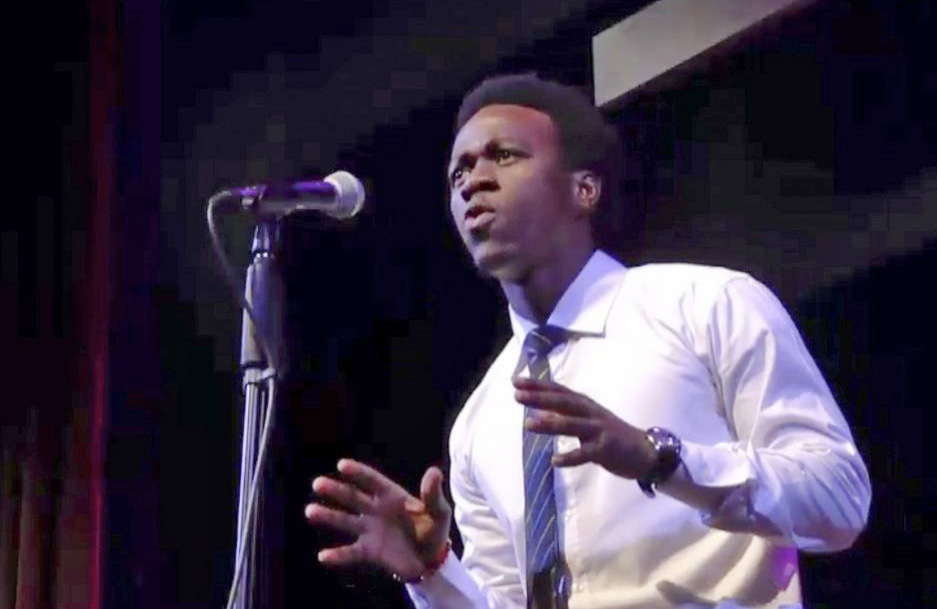 Allan Monga, a Deering High School junior, performs during a recent Poetry Out Loud competition.