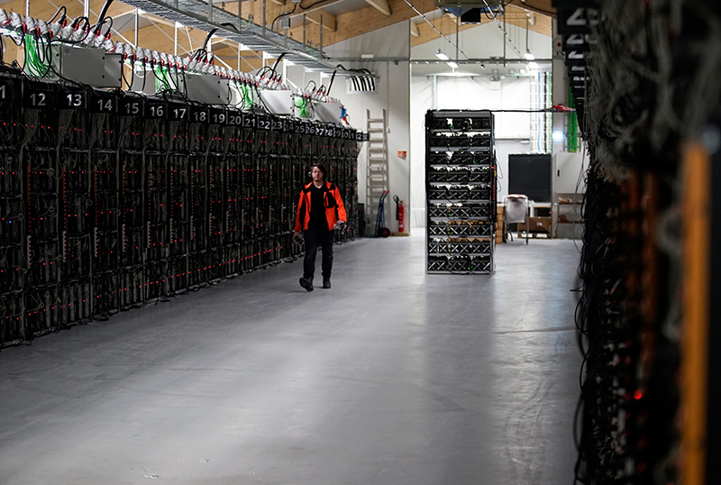 Computer rigs that run around the clock 'mining' bitcoin inside the Genesis Mining cryptocurrency mine in Keflavik, Iceland.