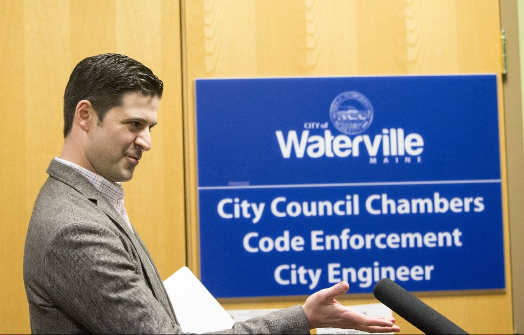 "Waterville Mayor Nick Isgro evades reporters' questions about his recent social media controversy Tuesday night before a city budget meeting, calling the reports ""fake news."""