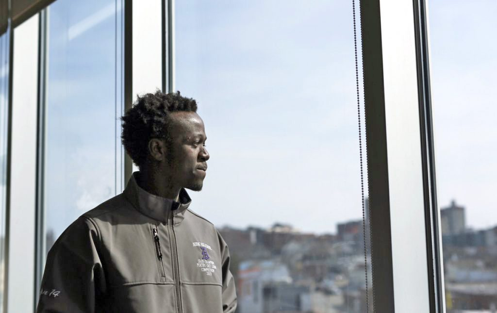 Allan Monga, 19, a Deering High junior and an asylum seeker from Zambia, won local- and state-level competitions in the Poetry Out Loud program.