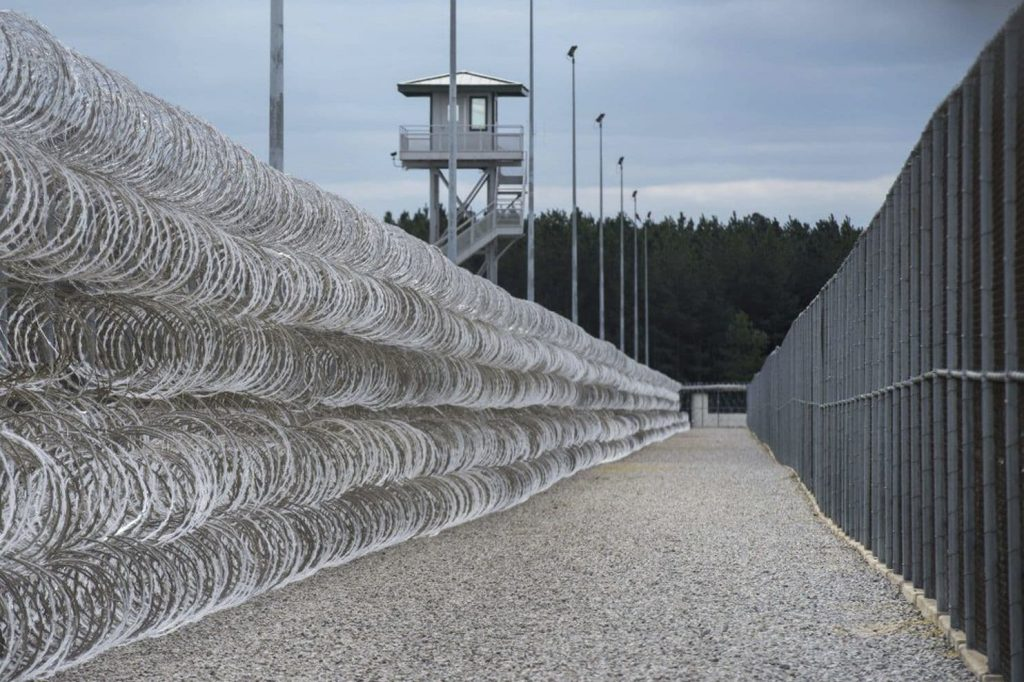 Razor wire protects a perimeter of the Lee Correctional Institution in Bishopville, S.C.