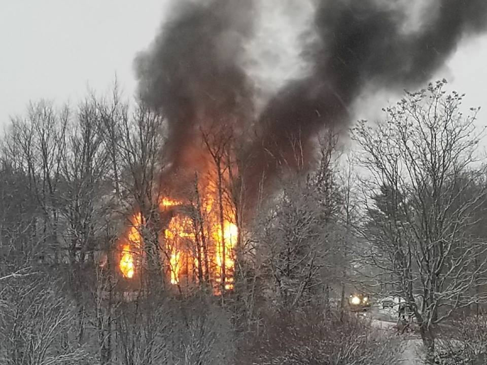A vacant home burns at 133 North Main St. in Andover on Friday night.
