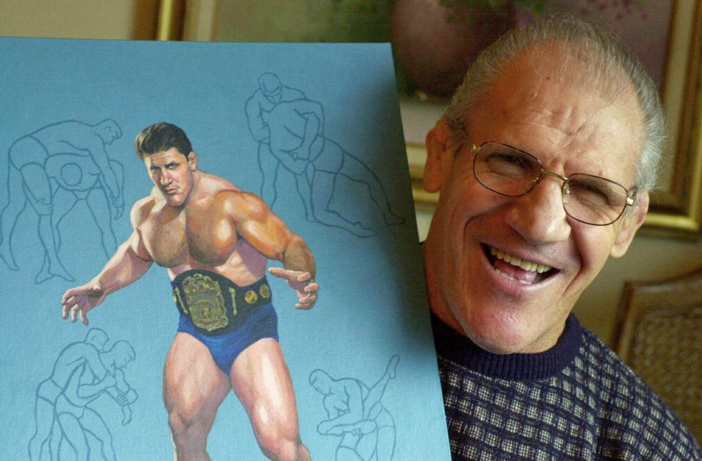 Former pro wrestler Bruno Sammartino, 65, poses in 2000 with a painting of him in his pro wrestling prime weighing 275 pounds in 1965 at age 35.