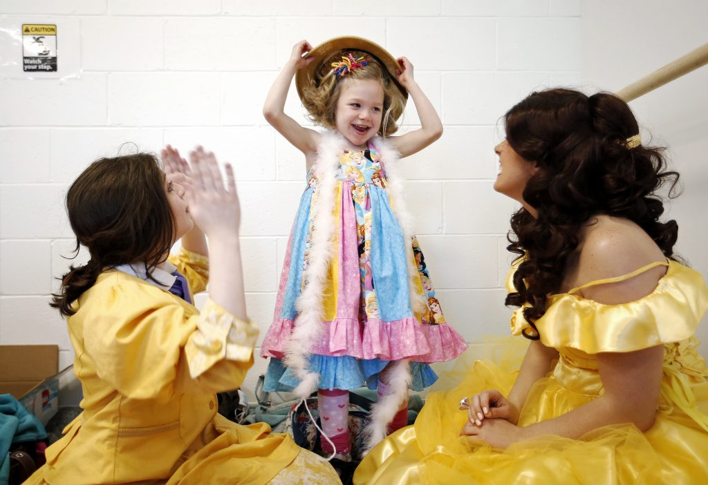 Katie Creedon, 6, of Buxton, who has CDKL5 deficiency, a rare disease that affects fewer than 1,000 people in the world -- plays with a costume pith helmet during her surprise birthday party on Saturday at Atlantic Dance Arts studio in Gorham. Shortly after Creedon arrived, 9