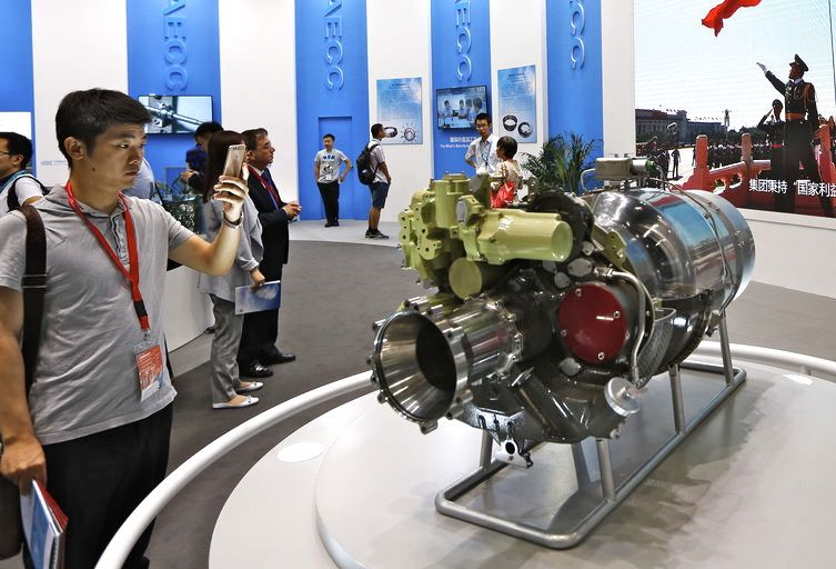Visitors look at aircraft components at the Aviation Expo China in Beijing.