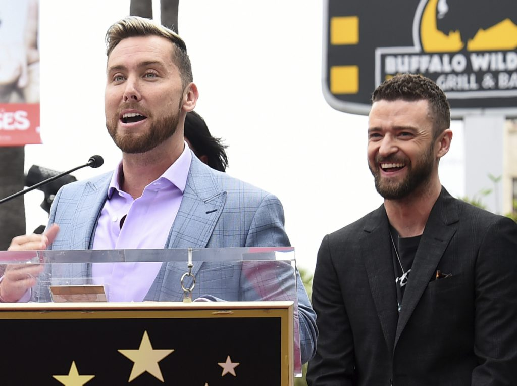 Lance Bass speaks at a ceremony honoring 'NSync with a star on the Hollywood Walk of Fame on Monday. At right is Justin Timberlake.