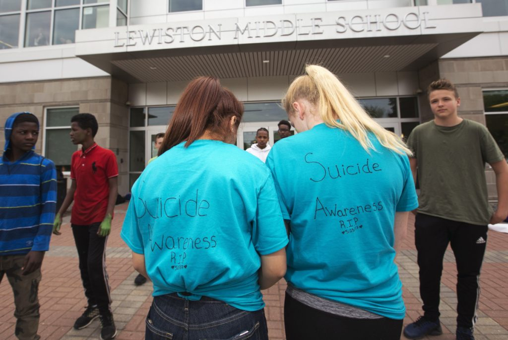 Lewiston Middle School students take part in an anti-bullying protest last May to mark a seventh-grader's death by suicide. School is where a young person's vulnerabilities are often most easily exacerbated.