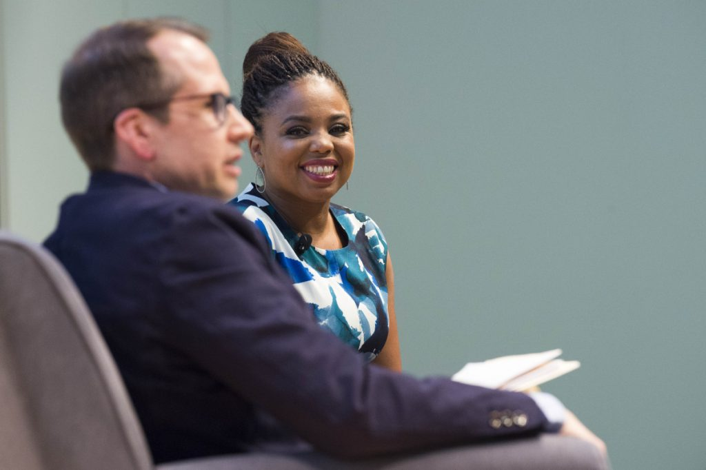 "Jemele Hill, right, smiles during an introduction by Justin McCann before her ""Freedom to Speak: A Conversation with Jemele Hill on Athletics and Activism"" event Tuesday night at Ostrove Auditorium at Colby College. (Staff photo by Michael G. Seamans)"