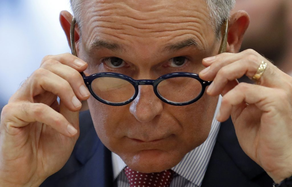 Environmental Protection Agency Administrator Scott Pruitt removes his glasses as he testifies at a hearing of the House Appropriations subcommittee for the Interior, Environment, and Related Agencies, on Capitol Hill, Thursday, April 26, 2018 in Washington. (AP Photo/Alex Brandon)