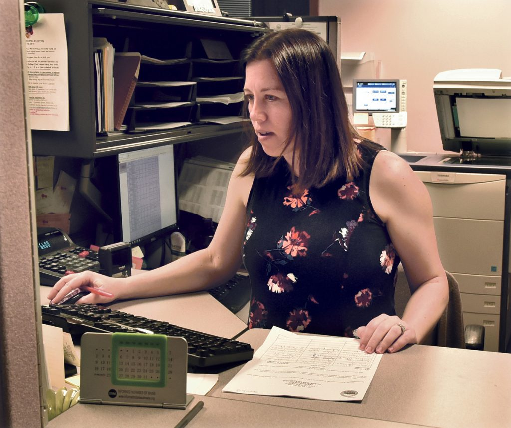Waterville Deputy Clerk Sarah Cross verifies signatures of residents that were handed in before the deadline for the petition to recall Mayor Nick Isgro on Wednesday. Cross said the clerk's office was busy with more than 200 signatures dropped off that will need to be verified in the next 10 days.