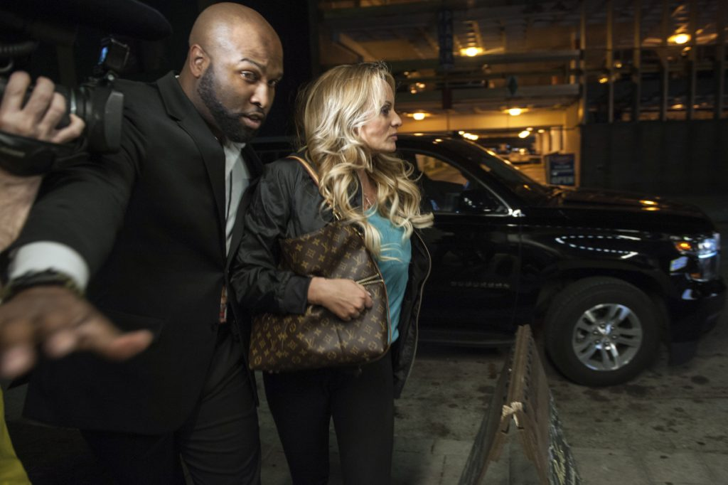 Adult film actress Stormy Daniels is escorted into an adult venue called Blush, by a bodyguard as she arrives Wednesday to perform in her show in downtown Pittsburgh. President Trump has acknowledged that he repaid his personal attorney Michael Cohen for a $130,000 payment to Daniels, directly contradicting the president's past statements.