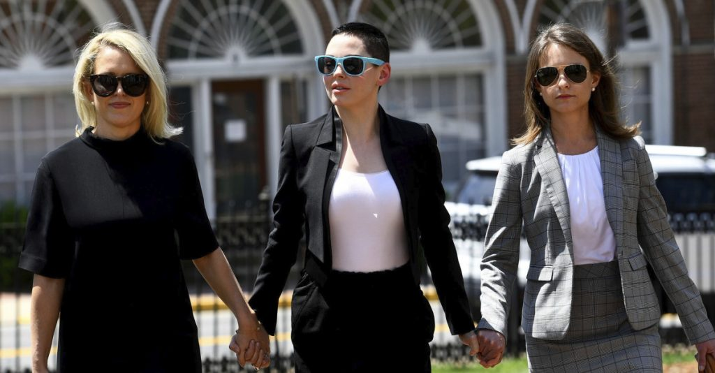 Actress Rose McGowan, center, and her attorney Jessica Carmichael, right, arrive for a preliminary hearing on her drug possession charge Thursday in Leesburg, Va.