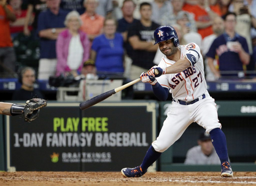 Houston's Jose Altuve strikes out with two runners on in the bottom of the ninth to end Thursday's game against the New York Yankees. New York rallied for three runs in the top of the ninth and Aroldis Chapman got his seventh save.