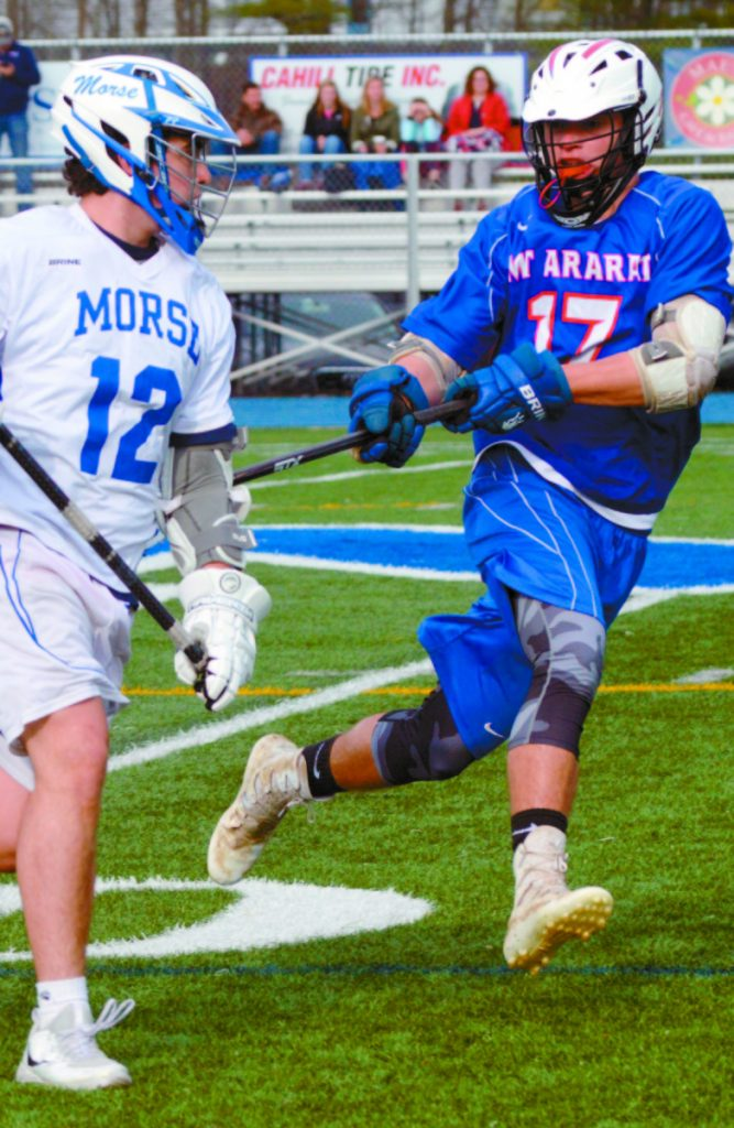 Zach Caouette of Mt. Ararat, right, plays tight defense on Jacob Brochu of Morse in Thursday's game in Bath.
