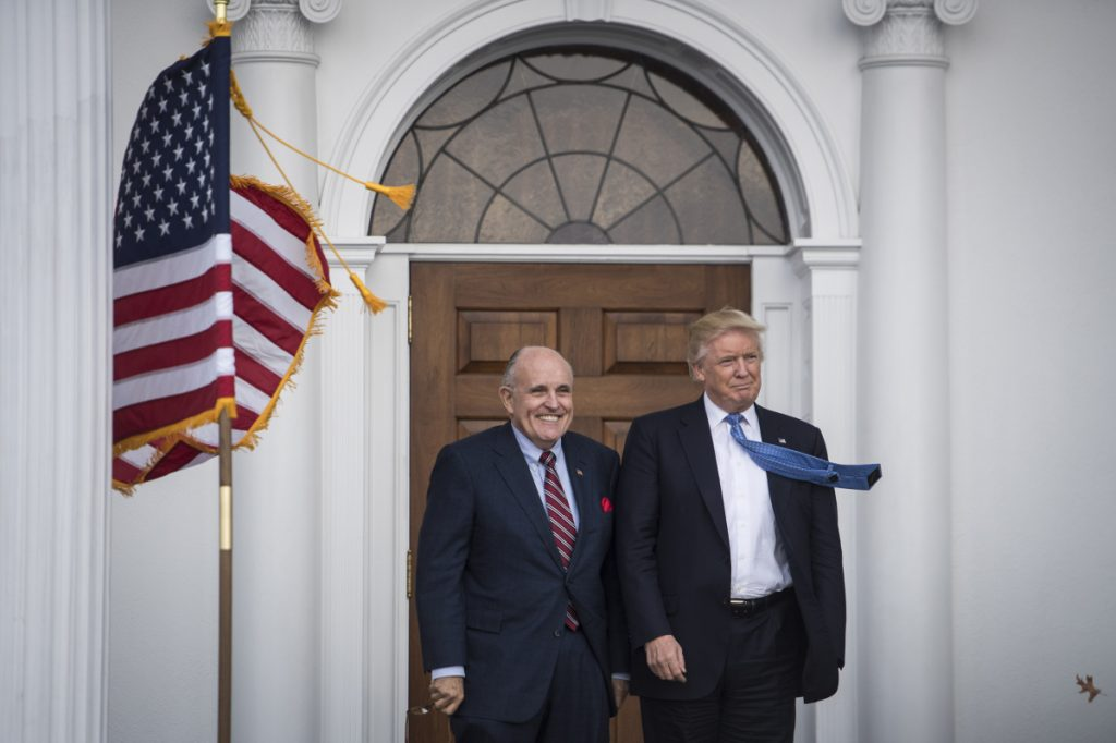 Then President-elect Donald Trump greets Rudy Giuliani at the clubhouse at Trump National Golf Club Bedminster in Bedminster Township, N.J. on Nov. 20, 2016.