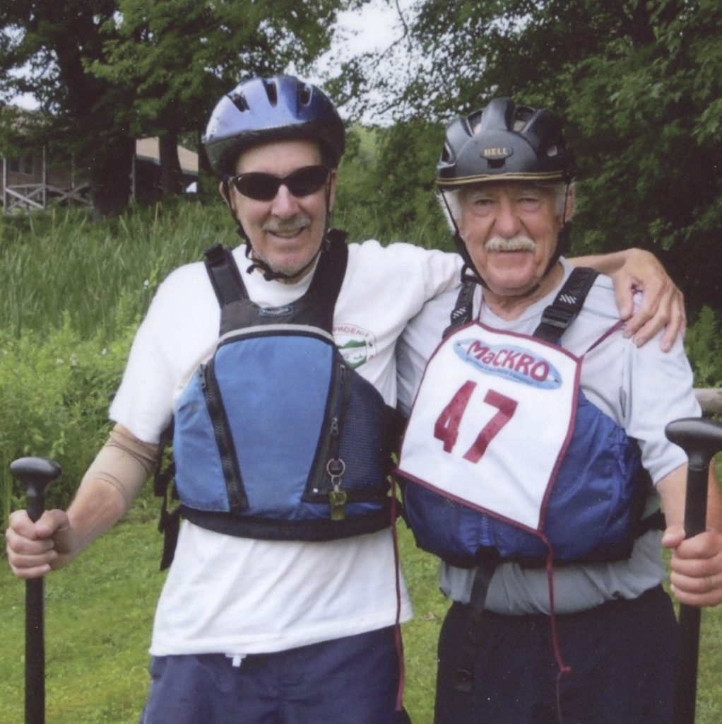 """Bucky Owen, left, and Frank Woodard, right, after finishing as a team in the National Whitewater Canoe Championships in the Penobscot River on July 26, 2015. The two raced together in canoe races in the 1970s and 1980s before teaming up together again in 2015, when they both were in their late 70s. """"Now that I think about it, we were like a couple of brothers,"""" Woodard said of their canoe team. """"It's special because such great coordination is required and you can tell when your coordination is perfect."""""""