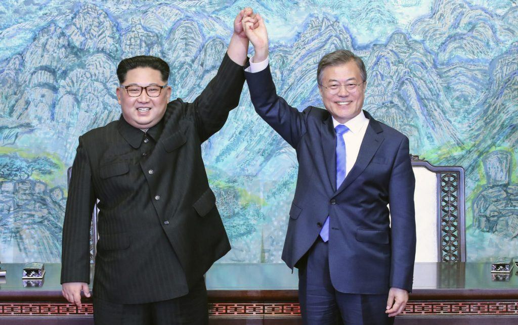 North Korean leader Kim Jong Un, left, and South Korean President Moon Jae-in raise their hands after signing a joint statement at the border village of Panmunjom in the Demilitarized Zone, South Korea, on April 27. An armistice halted the Korean War, but no treaty was signed.