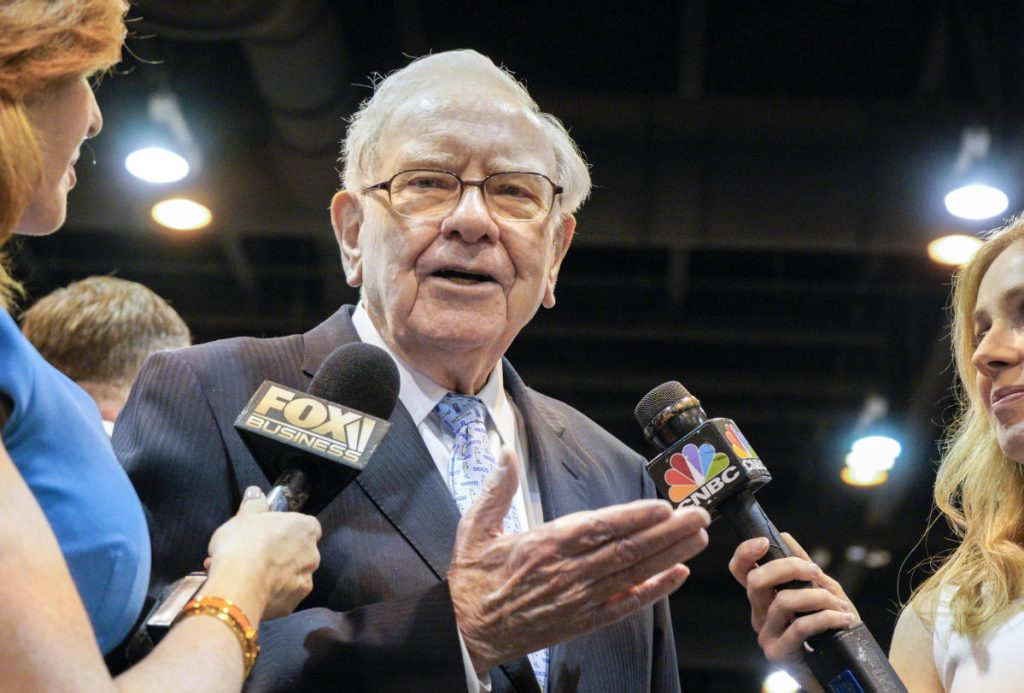Warren Buffett, chairman and CEO of Berkshire Hathaway, speaks to reporters during a tour of the exhibit floor at the CenturyLink Center in Omaha, Neb., on Saturday.