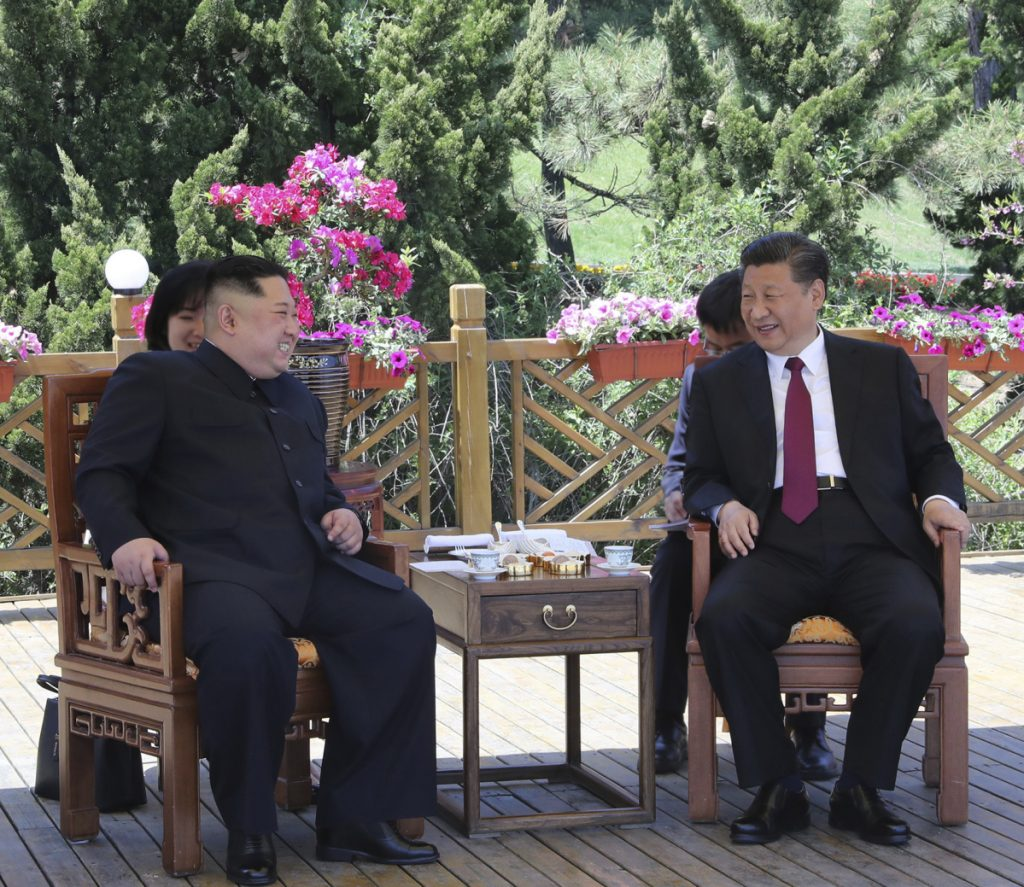 Chinese President Xi Jinping, right, speaks to North Korean leader Kim Jong Un in Dalian in northeastern China's Liaoning Province earlier this week.