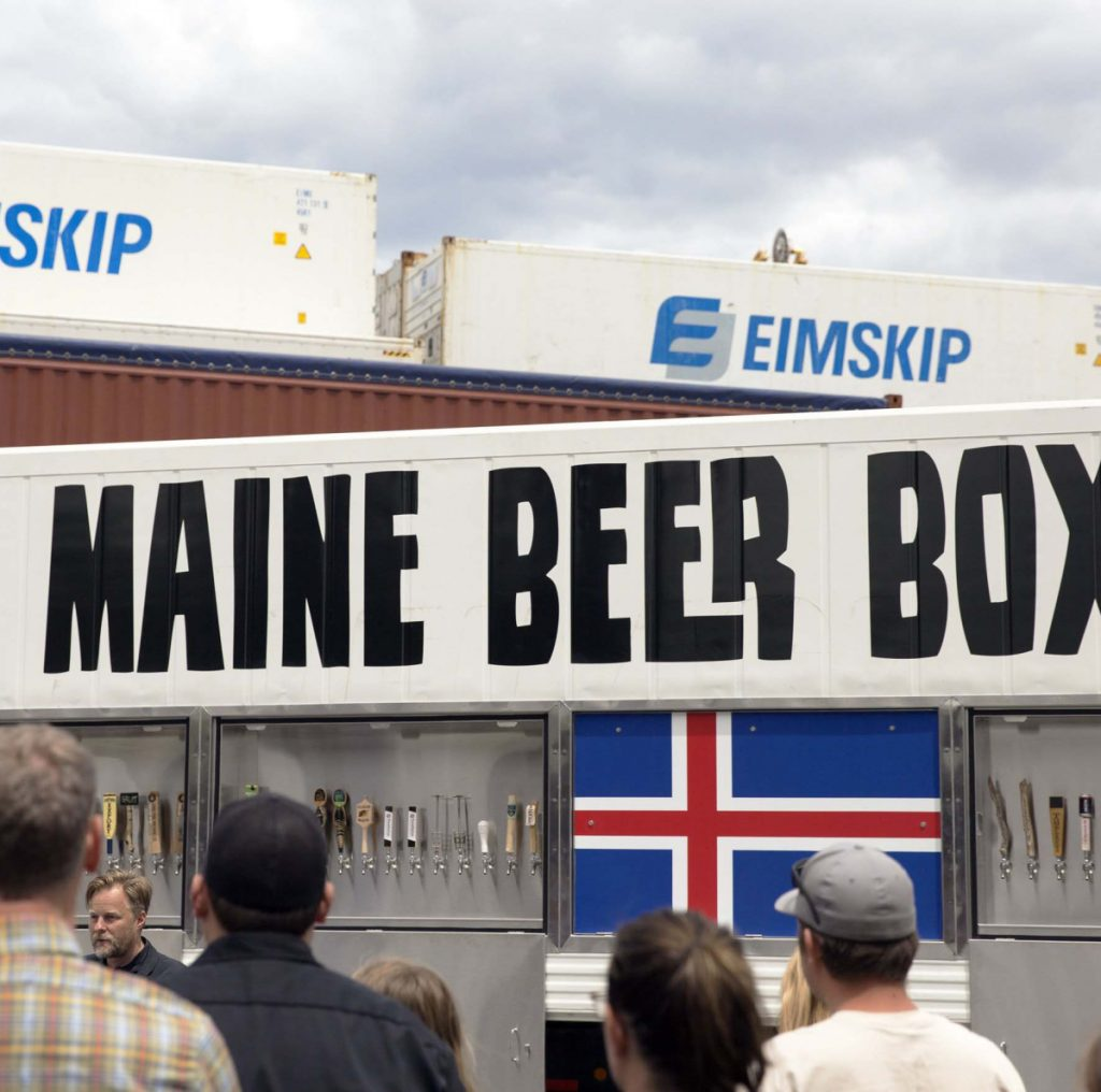 Dozens of Maine brewers gather last June at Eimskip on Portland's waterfront to bid bon voyage to the Maine Beer Box, a custom shipping container full of Maine-made brews bound for a beer festival in Iceland.