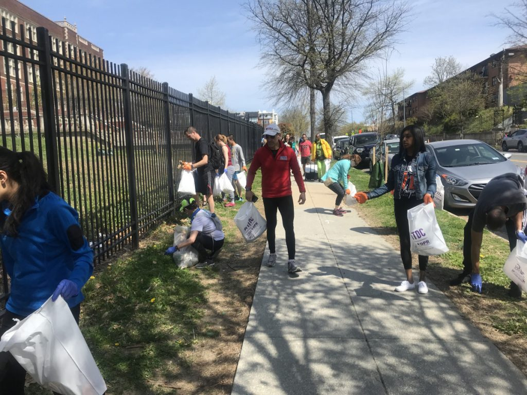Running coach Jeff Horowitz, in red, and ploggers pick up trash in Washington, D.C.