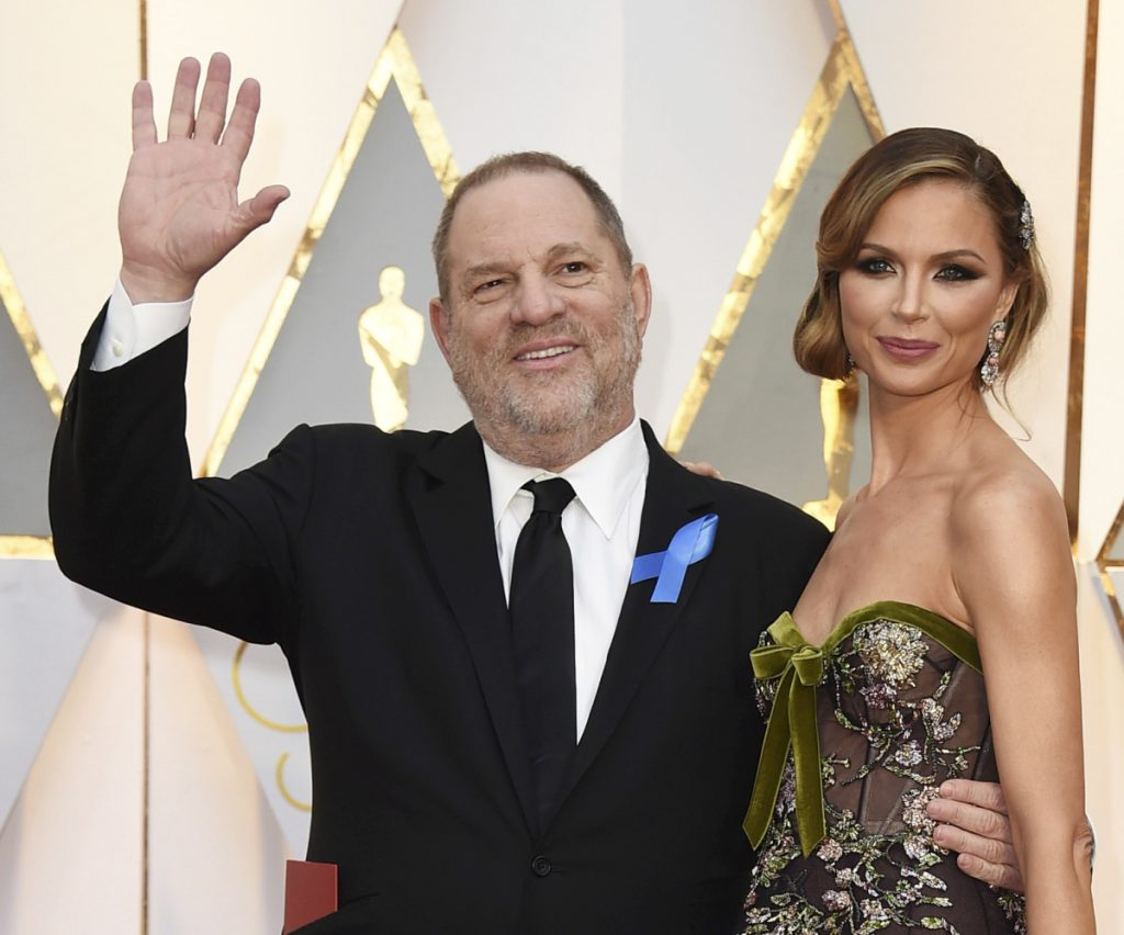 Producer Harvey Weinstein and fashion designer Georgina Chapman arrive at the Oscars in Los Angeles in 2017. Chapman, Weinstein's estranged wife, has given a tearful interview in Vogue magazine.