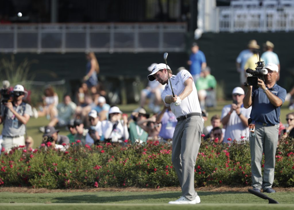 Webb Simpson hits from the drop zone after hitting a ball into the water on the 17th hole Friday during the second round of The Players Championship. Didn't matter. He tied the course record with a 63 and holds a five-shot lead.