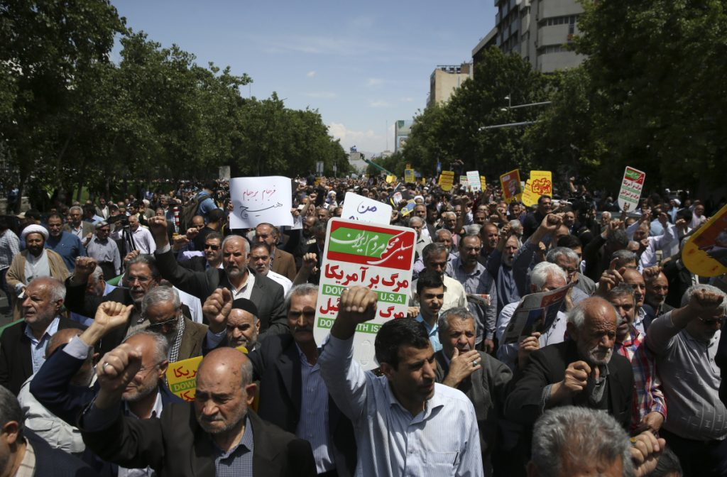 Iranian protesters chant slogans during an anti-U.S. gathering after their Friday prayers in Tehran, Iran. Thousands of Iranians took to the streets in cities across the country to protest President Trump's decision to pull out of the nuclear deal with world powers.