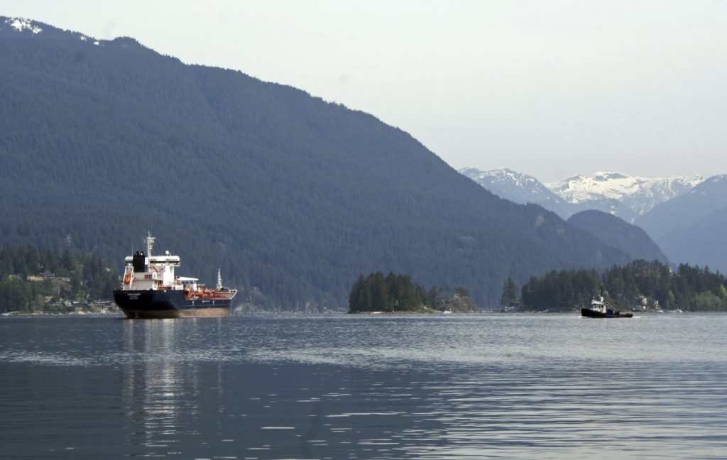 An oil tanker is anchored last week off the Kinder Morgan Inc. Westridge oil terminal in Vancouver, British Columbia, at the end of the Trans Mountain pipeline that begins in northern Alberta. A proposed expansion would triple the capacity of the existing pipeline to ship oil across the Canadian Rockies and to the Pacific Ocean, resulting in a sevenfold increase in the number of tankers operating in an area dependent on tourism and fishing.