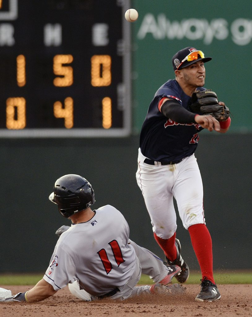 Jeremy Rivera turns the double play – one of four by the Sea Dogs in the game – as Binghamton's Patrick Mazeika slides into second base during Portland's 5-1 loss Friday night at Hadlock Field.
