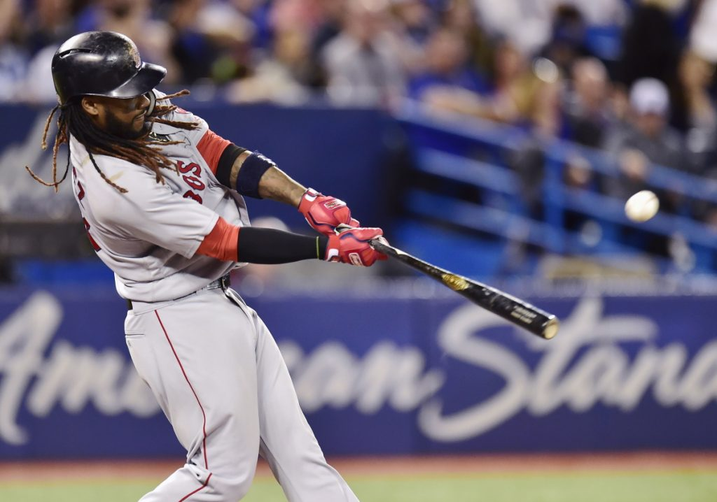Boston's Hanley Ramirez hits a two-run home run in the third inning of a 5-2 win over the Blue Jays on Saturday in Toronto.