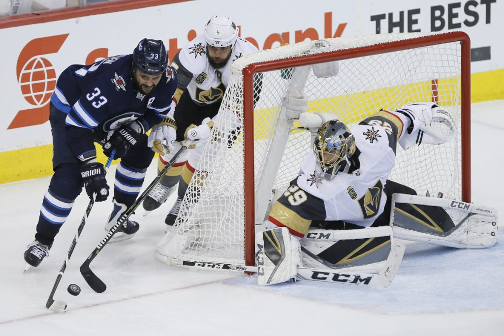 Winnipeg's Dustin Byfuglien attempts the wraparound on Vegas goaltender Marc-Andre Fleury during the third period of Game 1 of the NHL hockey playoffs Western Conference finals on Saturday night in Winnipeg. The Jets won, 4-2.