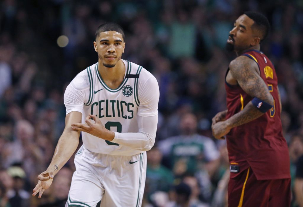 Celtics forward Jayson Tatum celebrates his 3-point basket as Cavaliers guard JR Smith looks on during the second quarter of Boston's 108-83 win in Game 1 of the Eastern Conference finals on Sunday in Boston.