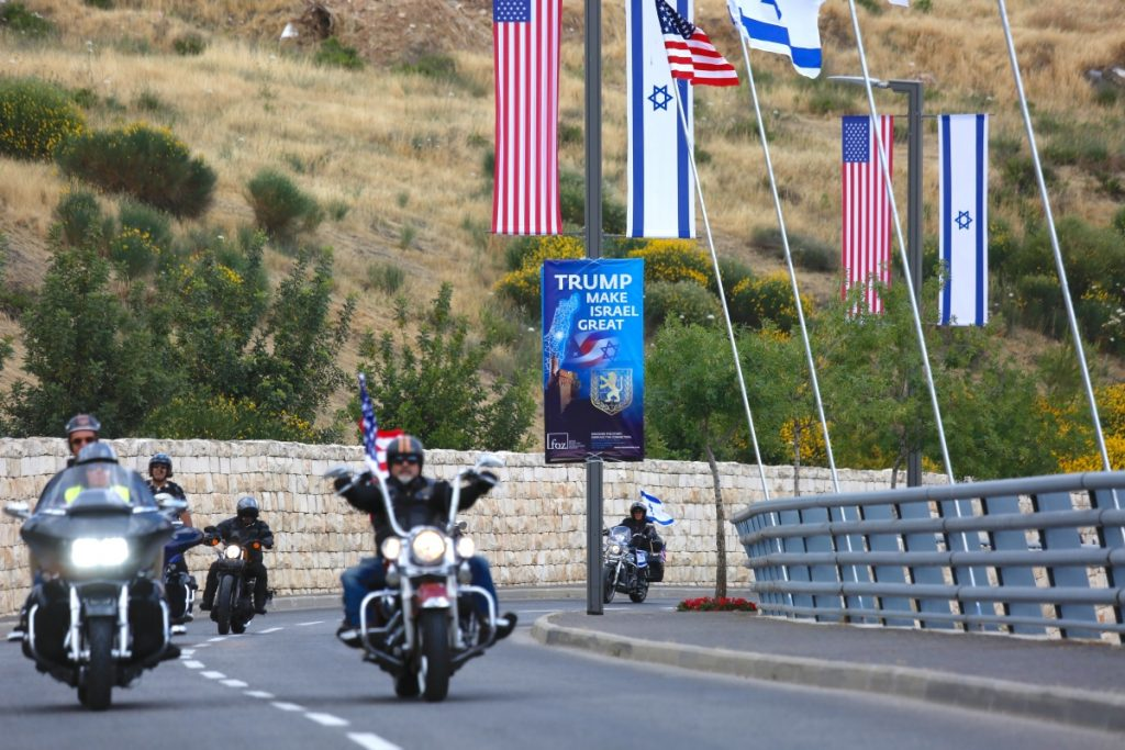Members of a motorcycle club arrive on a road leading to the new U.S. Embassy in Jerusalem during a group ride Sunday from the site of the old embassy in Tel Aviv. Both sides of the Israeli-Palestinian conflict claim Jerusalem as a capital.