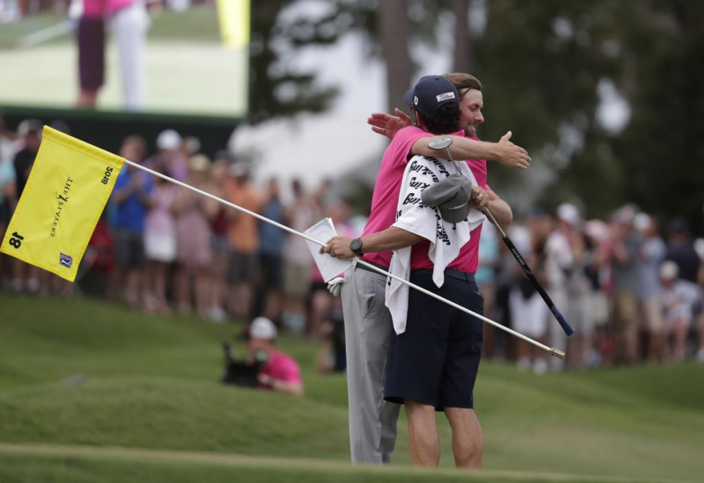 Webb Simpson and his caddie Paul Tesori congratulate each other after winning The Players Championship Sunday in Ponte Vedra Beach, Fla.