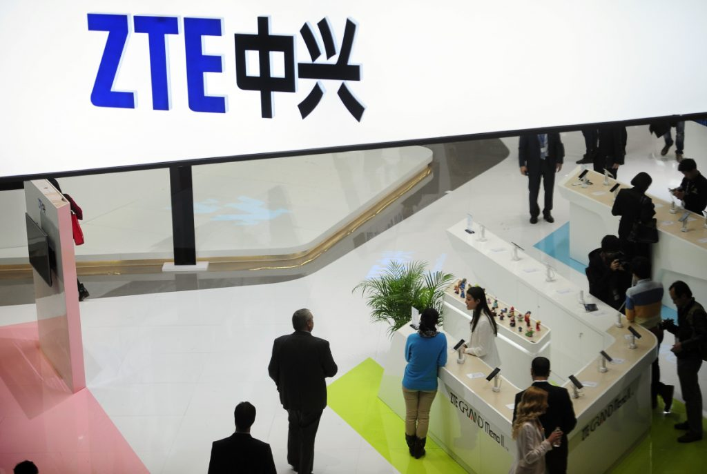 People gather at the ZTE booth at the Mobile World Congress, the world's largest mobile phone trade show, in Barcelona, Spain, in 2014. ZTE halted operations after U.S. authorities cut off its access to American suppliers.