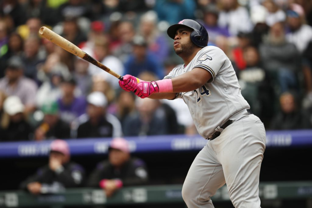 Jesus Aguilar follows the flight of his three-run homer Sunday that helped the Milwaukee Brewers to a 7-3 victory against the Colorado Rockies.