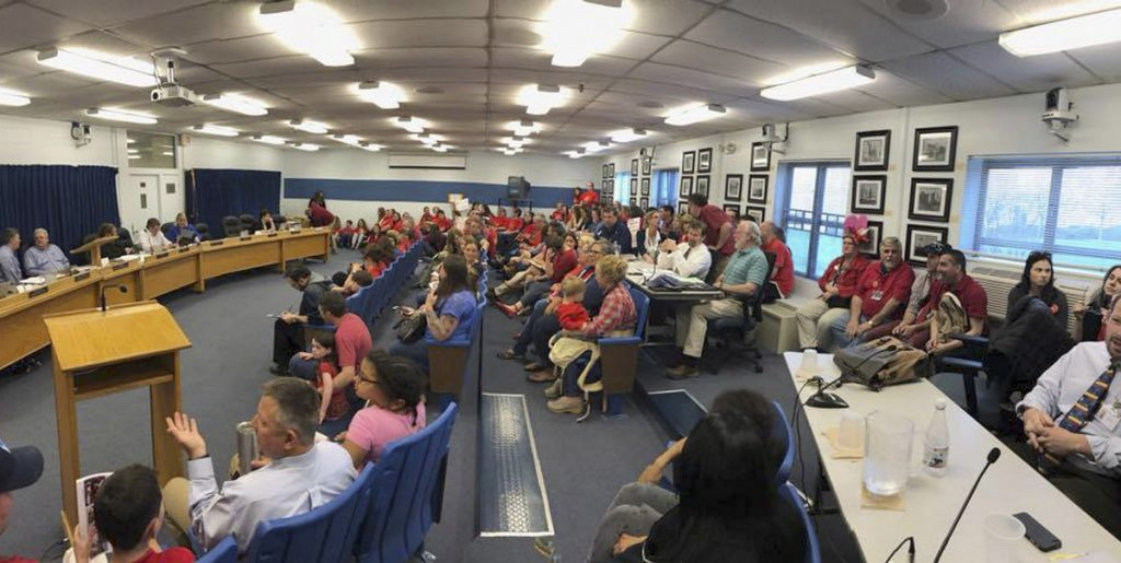 More than 100 Westbrook teachers staged a demonstration at a school committee meeting Wednesday to call for a new contract. Many have been wearing red to school in solidarity with similar protests in other states.