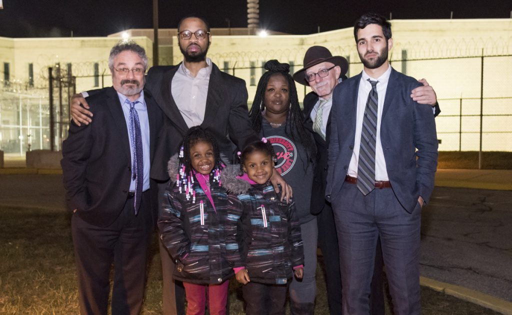 From left, Michael Wiseman, Isaiah McCoy, Disaiah Johnson, Herb Mondros and Phil Primason with McCoy's two daughters after he walked out of Howard R. Young Correctional Institution in Wilmington, Del., as a free man in January of 2017. Isaiah McCoy enjoyed the limelight that came with sharing his story after he left Delaware's death row a free and exonerated man. Now, he's in a federal detention center in Honolulu.