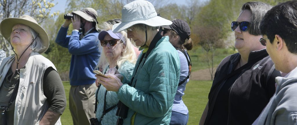 Cheryl Ring, center, takes note of birds she sighted Sunday at the Viles Arboretum in Augusta during training on how to gather data on avian species for the Maine Bird Atlas.