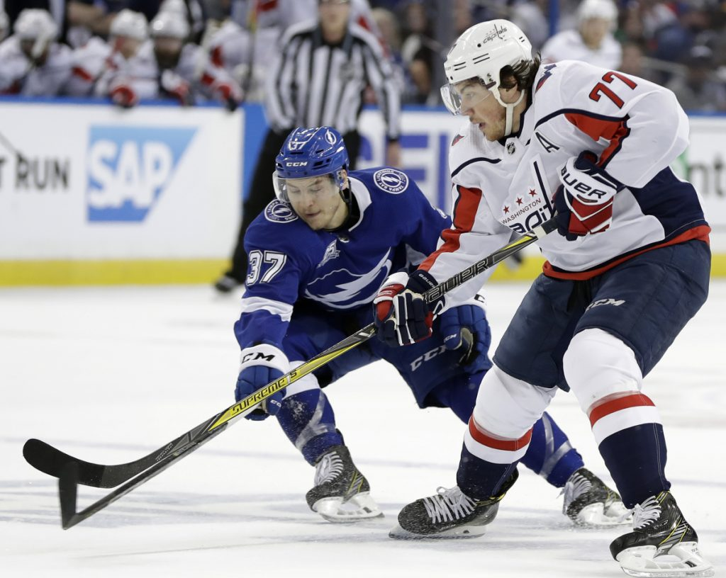 Tampa Bay center Yanni Gourde knocks the puck away from T.J. Oshie of the Capitals during Game 2 of the Eastern Conference finals Sunday night. Washington won, 6-2.