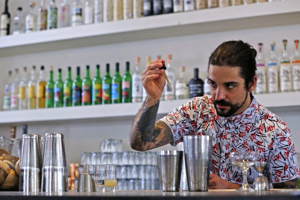 Associated Press/Damian Dovarganes Beverage director Maxwell Reis adds a few drops of cannabidiol CBD extract to a mixed drink at the Gracias Madre restaurant in West Hollywood, Calif. The hemp-derived CBD extract is popping up in everything, including cosmetics, chocolate bars, bottled water and pet treats.