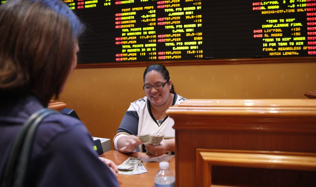Soon much of the country will see a sight that's so common in Nevada but nowhere else in the nation – a teller paying off successful bettors as rows of point spreads line a wall.