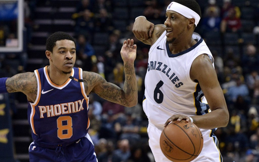 Memphis guard Mario Chalmers drives by Phoenix guard Tyler Ulis during a game on Jan. 29 that had a big impact on the race for the NBA's worst record.