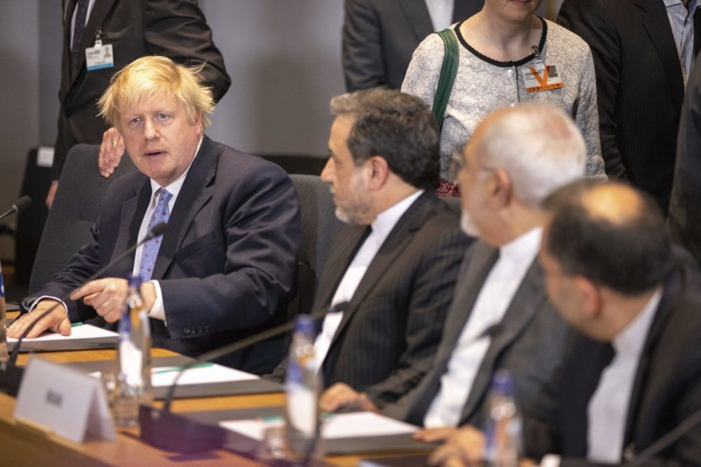 British Foreign Secretary Boris Johnson, left, talks during a meeting of the foreign ministers from Britain, France and Germany with the Iran Foreign Minister Javad Zarif and EU foreign policy chief Federica Mogherini in Brussels on Tuesday. Major European powers sought Tuesday to keep Iran committed to a deal to prevent it from building a nuclear bomb despite deep misgivings about Tehran's Middle East politics and President Trump's vehement opposition.